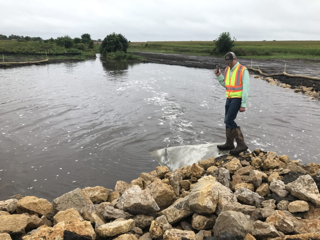 Dobbins 1 site - downstream berm - Sept 2018 flooding -- project partially done - CRWD project manager Cody Fox pictured